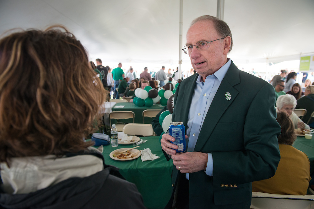 Charles W. Beck Jr. speaks with attendees of the homecoming tailgate party at Tailgreat Park on Saturday, October 8, 2016.