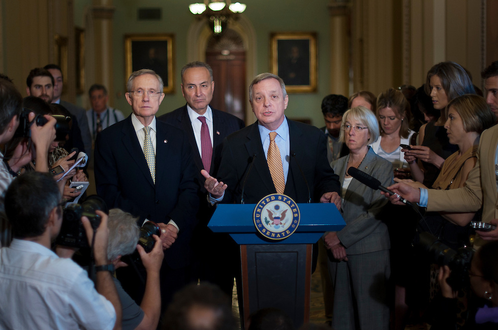 Senator DICK DURBIN (D-IL) speaks to reporters during a press conference on Capitol Hill Friday. Senate Majority Leader HARRY REID (D-NV) said his budget legislation would increase the nation's borrowing authority until March, 2013. He also said that he would not accept a short-term debt limit increase as Republicans are insisting.