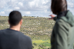 17 April 2019, Tulkarem, West Bank, Occupied Palestinian Territories: Ecumenical Accompaniers from the World Council of Churches Ecumenical Accompaniment Programme in Palestine and Israel look out over Yanoun. The village of Yanoun sits on a hillside in the Nablus Governorate of the West Bank. There is only one road into the village, which is otherwise surrounded on all sides by Israeli settlements.