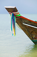 Bow of a long tail boat with traditional flags Gulf of Thailand Thailand&#xA;<br />