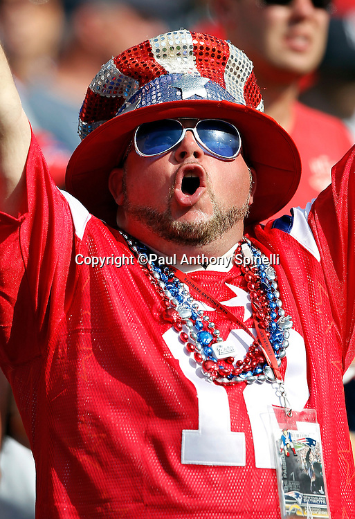 A Buffalo Bills fan wearing beads and a wild hat cheers during the NFL week 3 football game against the New England Patriots on Sunday, September 25, 2011 in Orchard Park, New York. The Bills won the game 34-31. ©Paul Anthony Spinelli