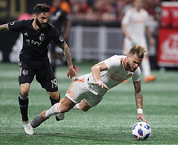 May 9, 2018 - Atlanta, GA, USA - Atlanta United defender Leandro Gonzalez Pirez is tripped up by Sporting Kansas City midfielder Cristian Lobato during the second half on Wednesday, May 9, 2018, in Atlanta. Sporting Kansas City won, 2-0. (Credit Image: © Curtis Compton/TNS via ZUMA Wire)