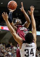 South Carolina's Chris Silva (30) makes a shot over Texas A&M's Tyler Davis (34) during the second half of an NCAA college basketball game, Saturday, Feb. 6, 2016, in College Station, Texas. South Carolina won 81-78. (AP Photo/Sam Craft)