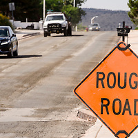 Traffic moves along a recently milled section of Red Rock Drive in Gallup Tuesday.