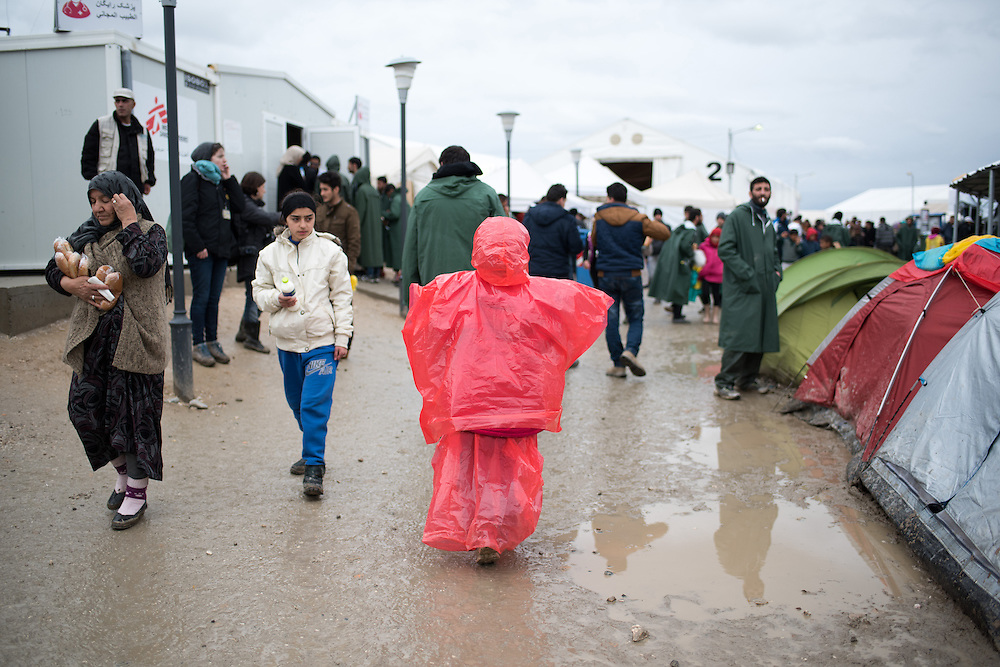 Refugees walk in the transit camp of Idomeni, Greece. <br /> <br /> Thousands of refugees are stranded in Idomeni unable to cross the border. The facilities are stretched to the limit and the conditions are appalling.