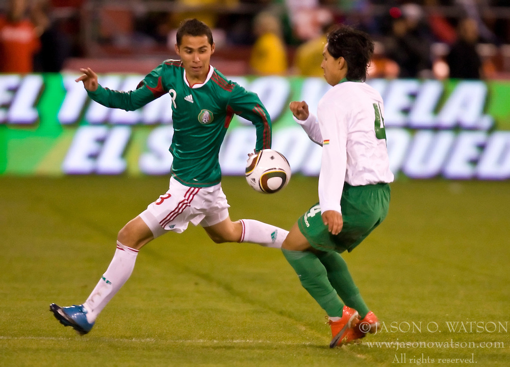 February 24, 2010; San Francisco, CA, USA;  Mexico midfielder Israel Castro (8) and Bolivia defender Marvin Bejarano (4) during the first half at Candlestick Park. Mexico defeated Bolivia 5-0.