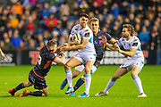Adam Hastings (#10) of Glasgow Warriors looks to break the tackle of Mark Bennett (#13) of Edinburgh Rugby during the 1872 Cup second leg Guinness Pro14 2019_20 match between Edinburgh Rugby and Glasgow Warriors at BT Murrayfield Stadium, Edinburgh, Scotland on 28 December 2019.