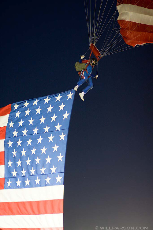 A skydiver enters the arena with a huge American Flag during the PBR rodeo at the Del Mar Fairgrounds in Del Mar, California on July 26th, 2008.