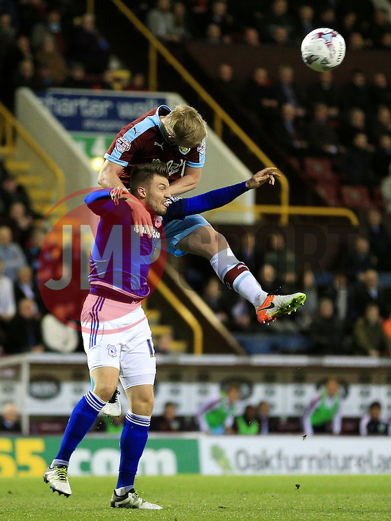 Anthony Pilkington of Cardiff City challenges Burnley's Ben Mee  - Mandatory by-line: Matt McNulty/JMP - 05/04/2016 - FOOTBALL - Turf Moor - Burnley, England - Burnley v Cardiff City - SkyBet Championship