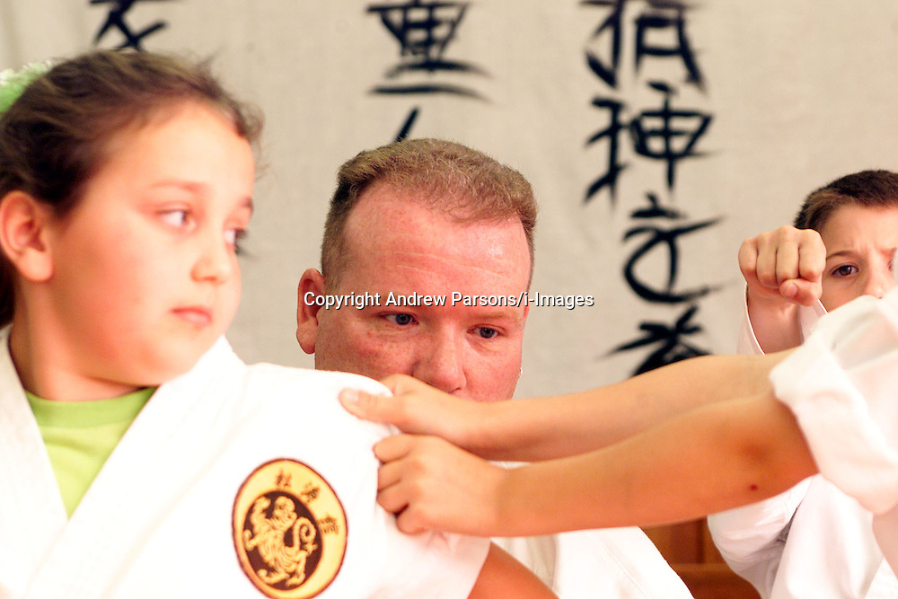 Portraits of Father Seamus at the Mulhollands Karate club, West Beckton, London, July 16, 2000..Photo by Andrew Parsons/i-Images..