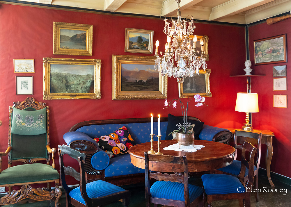 An atmospheric room full of antiques and old paintings in the Walaker Hotell, Solvorn, Lustra Fjord, Vestlandet, Norway, Europe