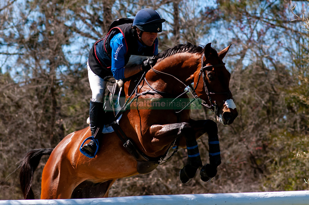 March 22, 2019 - Raeford, North Carolina, US - March 23, 2019 - Raeford, N.C., USA - PHILLIP DUTTON of the United States riding FERNHILL SINGAPORE  competes in the cross country CCI-4S division at the sixth annual Cloud 11-Gavilan North LLC Carolina International CCI and Horse Trial, at Carolina Horse Park. The Carolina International CCI and Horse Trial is one of North AmericaÃ•s premier eventing competitions for national and international eventing combinations, hosting International competition at the CCI2*-S through CCI4*-S levels and National levels of Training through Advanced. (Credit Image: © Timothy L. Hale/ZUMA Wire)