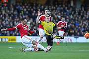 Chris Smalling of Manchester United beats Ben Watson of Watford in a tackle during the Barclays Premier League match between Watford and Manchester United at Vicarage Road, Watford, England on 21 November 2015. Photo by Phil Duncan.