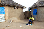 Balila doing her homework at her home in Tinguri, Ghana.