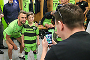 Forest Green Rovers Christian Doidge(9) poses with a matchday mascot during the EFL Sky Bet League 2 match between Forest Green Rovers and Milton Keynes Dons at the New Lawn, Forest Green, United Kingdom on 30 March 2019.