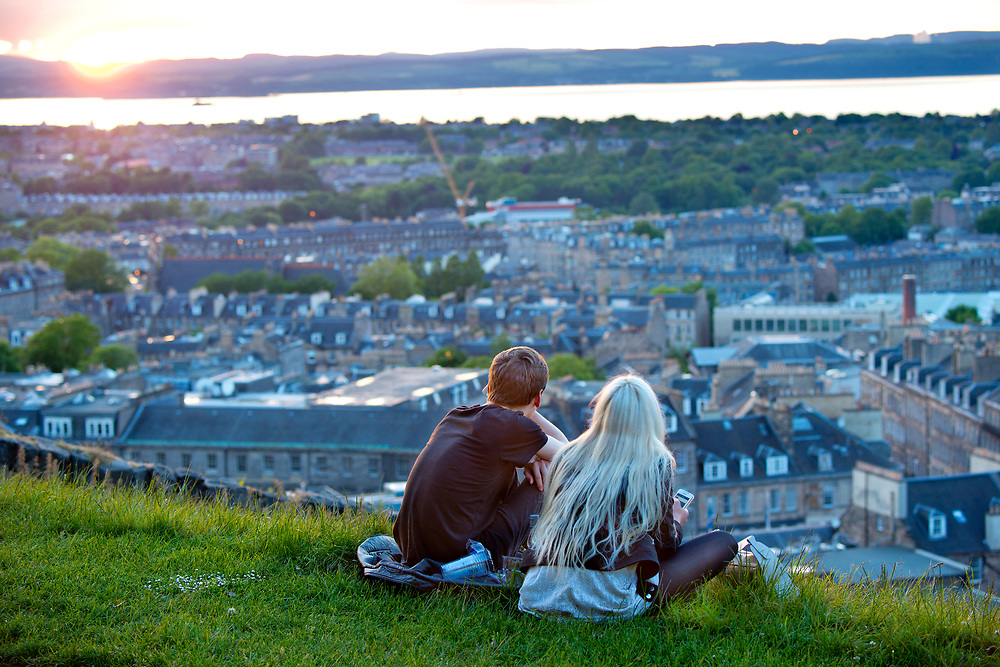 Couple tales in the Calton Hill view overlooking Edinburgh, Scotland.