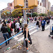 November 1, 2015 - New York, NY : A runner pauses to stretch along 5th Ave., at E 116th St. in Harlem during the 2015 TCS New York City marathon on Sunday.<br />  CREDIT: Karsten Moran for The New York TImes