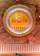 A machine-age, Art Deco, brass medallion, or roundel, on the Empire State Building's marble-walled lobby -- one of 11 such roundels, each honoring a different technology or craft essential to the construction of the great building.