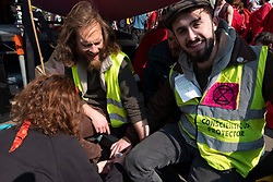 © Licensed to London News Pictures. 15/04/2019. London, UK. Extinction Rebellion environmental protesters super glue themselves to a pink boat during a sit down protest in Oxford Circus stopping traffic as they attempt bring central London to a standstill by mounting 24-hour protests. Photo credit: Ray Tang/LNP