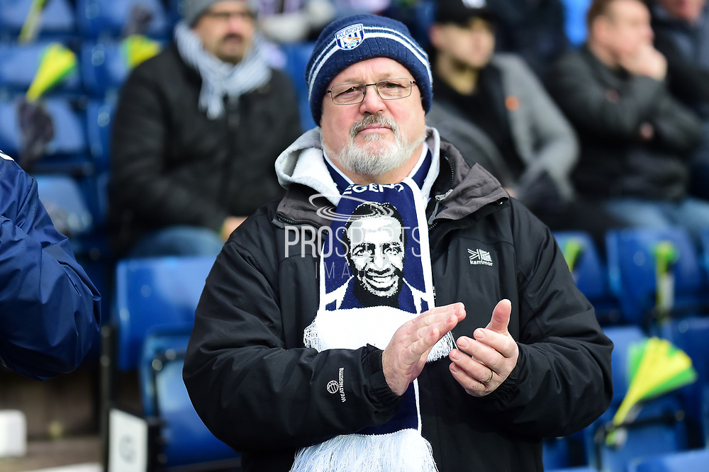 An Albion fan in his Cyrille Regis scarf during the Premier League match between West Bromwich Albion and Southampton at The Hawthorns, West Bromwich, England on 3 February 2018. Picture by Dennis Goodwin.