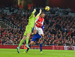 LONDON, ENGLAND - Saturday, November 22, 2014: Arsenal's Kieran Gibbs clashes with goalkeeper Wojciech Szczesny leading to the own goal for Manchester United during the Premier League match at the Emirates Stadium. (Pic by David Rawcliffe/Propaganda)