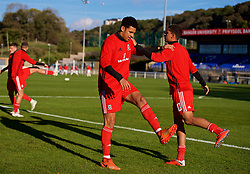 BANGOR, WALES - Monday, October 15, 2018: Wales' Ben Cabango and Brennan Johnson during the pre-match warm-up before the UEFA Under-19 International Friendly match between Wales and Poland at the VSM Bangor Stadium. (Pic by Paul Greenwood/Propaganda)