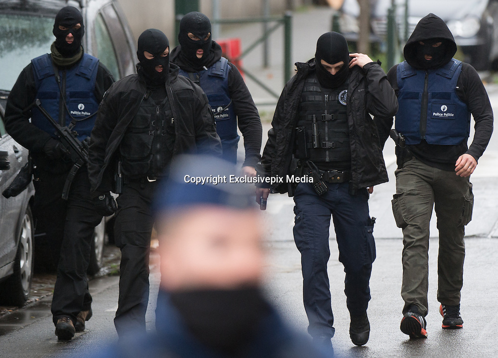Nov. 16, 2015 - Brussels, BELGIUM - <br /> BRUSSELS, BELGIUM:<br /> <br /> Search for Paris Terror Suspect in Brussels<br /> <br /> Policemen pictured during searchings at a house in the Delaunoystraat - Rue Delaunoy in Sint-Jans-Molenbeek / Molenbeek-Saint-Jean, Brussels on Monday 16 November 2015. During the weekend searches were carried out and multiple people were arrested in relation to Friday's terrorist attacks in Paris. Several terrorist attacks in Paris, France, have left at least 129 dead and 350 injured. Most people were killed during a concert in venue Bataclan, the other targets were a restaurant and a soccer game. The attacks have been claimed by Islamic State.<br /> ©Exclusivepix Media