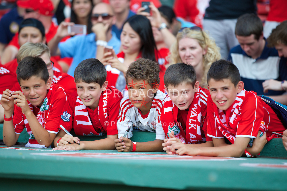 BOSTON, USA - Tuesday, July 22, 2014: Young Liverpool supporters watch a training session at Fenway Park in Boston on two one of the club's USA Tour. (Pic by David Rawcliffe/Propaganda)