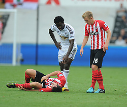 Swansea City's Wilfried Bony checks to see if Southampton's Maya Yoshida is okay after getting sent off. - Photo mandatory by-line: Alex James/JMP - Mobile: 07966 386802 20/09/2014 - SPORT - FOOTBALL - Swansea - Liberty Stadium - Swansea City v Southampton  - Barclays Premier League