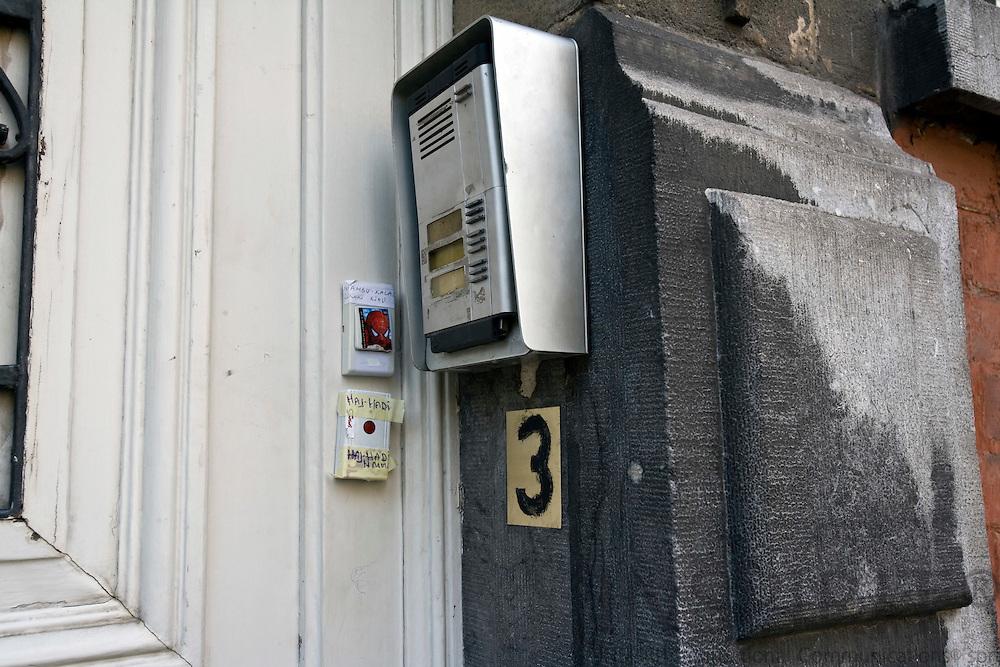 BRUSSELS - BELGIUM - 14 OCTOBER 2008 -- House number 3 placed under door phone and bells. Photo: Erik Luntang/INSPIRIT Photo