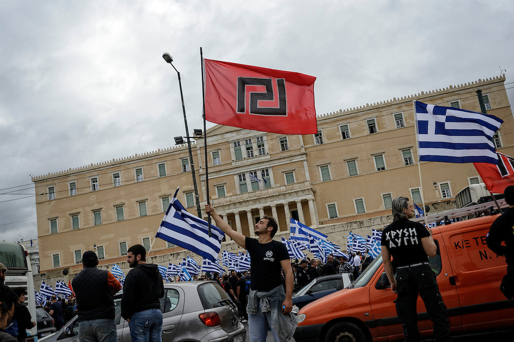 GREECE ATHENS JUNE 04 2014 Golden Dawn supporters demonstrate in front of Parliament ahead of vote on lifting party leaders's immunity. Extreme-right Golden Dawn party came third in recent EU elections after gaining almost 10% of the vote despite its leadership detained pending trial on charges of belonging to a criminal organisation.