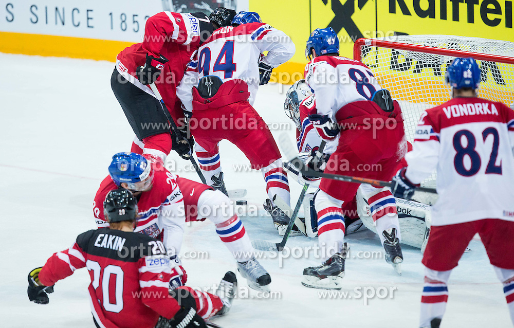 Sean Couturier of Canada vs Dominik Simon of Czech Republic, Jakub Nakladal of Czech Republic and Ondrej Pavelec of Czech Republic during Ice Hockey match between Canada and Czech Republic at Semifinals of 2015 IIHF World Championship, on May 16, 2015 in O2 Arena, Prague, Czech Republic. Photo by Vid Ponikvar / Sportida