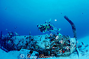 divers swim over wreck of WWII Corsair fighter plane, South Shore, Oahu, Hawaii ( Pacific ), MR 288-289