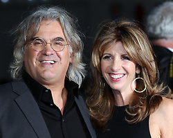 Paul Greengrass and wife arriving for the premiere of Captain Phillips on the opening night of the London Film Festival, Wednesday, 9th October 2013. Picture by Stephen Lock / i-Images