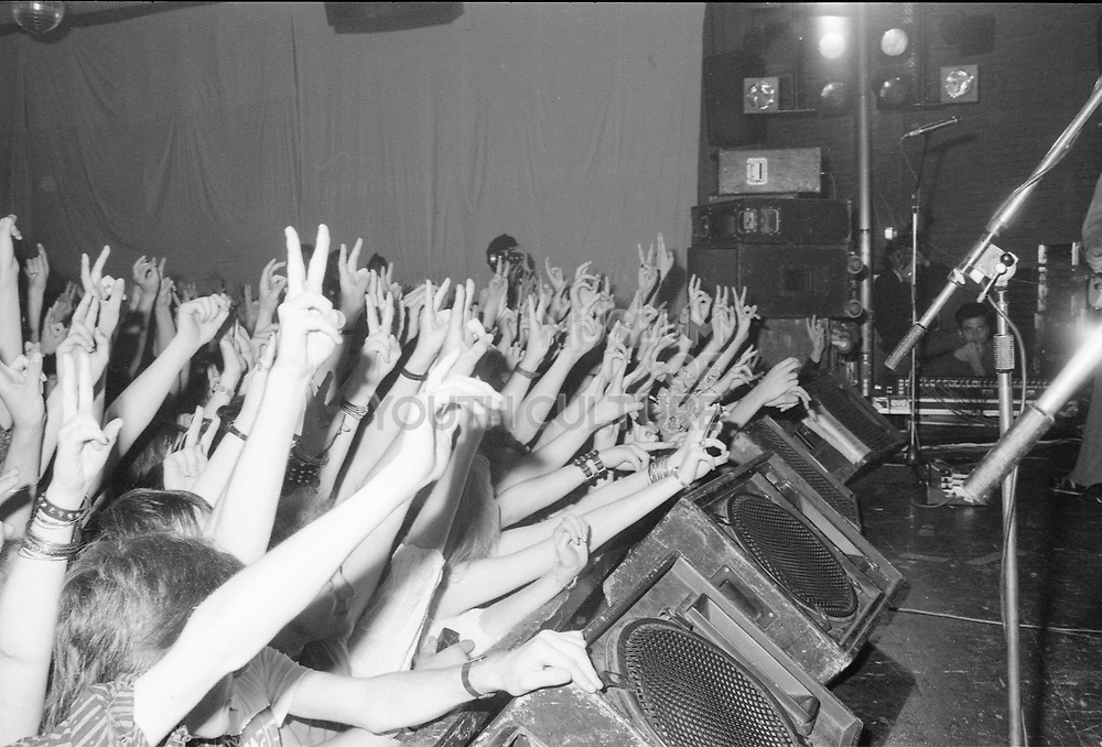 Crowd showing peace sign at Doctor and the Medics gig, Magical Mystery Tour Summer, UK, 1986.