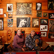 German wolf researcher Werner Freund, 79, his wife Erika, 72, and their cat Max sit in the living room in their house near the wolves park in Merzig in the German province of Saarland January 24, 2013. Freund established a home for wolves in 1972 and raised more than 70 animals in the last 30 years. Freund had to become a wolf among wolves to be accepted by the pack. Picture taken January 24, 2013.  REUTERS/Lisi Niesner  (GERMANY)