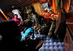 A Mongolian worshipper prays (front) during a Shaman healing ritual conducted by Mongolian Shaman brothers Gankhuyag (C-L) and Batgerel Batmunkh (C-R) as their female assistants help to translate and offer food in their ger in Ulan Bator, Mongolia, 04 July 2012. Mongolian brothers Gankhuyag and Batgerel Batmunkh share a similar fate. Both were construction workers before fate calls on them to take on their Shamanic roles to serve the spirits. Shamanism comes from the term 'shamans' that refers to priests or mediums that acts as vessels for spirits, gods and demons to communicate with the human world. In Mongolia, they adhere to the ancient beliefs of Tengrism, where spirits live in all of nature, in the sun, moon, lakes, rivers, mountains, and trees.