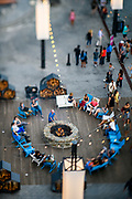"WASHINGTON DC - June, 8: Patrons gather around the fire pit at the District Wharf in the Southwest Waterfront neighborhood of Washington DC Friday, June 8, 2018. <br /> <br /> The Wharf is DC's latest attempt to be a ""real"" city. It took multiple agencies and act of congress to get it built. Did they repeat the mistakes of urban renewal (which moved lower income people out of the neighborhood)? Yes and no. People will still be driven out, but this time around the neighborhood is integrated more.<br /> (Photo by Matt Roth for The Washington Post)"