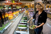 Mariel Booth, a professional model and New York University student, chooses lunch items from the salad bar section of a Whole Foods near her apartment in New York city. (Mariel Booth is featured in the book What I Eat: Around the World in 80 Diets.) The caloric value of her day's worth of food on a day in the month of October was 2400 kcals.   At a healthier weight than when modeling full-time, she feels good but laments that she's making much less money. MODEL RELEASED.