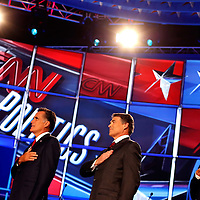 TAMPA, FL -- September 12, 2011 -- Republican Presidential candidates Rep. Michele Bachmann left to right, Gov. Mitt Romney, Gov. Rick Perry, and Rep. Ron Paul stand during the National Anthem the CNN/Tea Party Republican Debate at the Florida State Fairgrounds on Monday, September 12, 2011.  Eight Republican Presidential candidates squared off with host Wolf Blitzer in the battleground state of Florida for the 2012 Election.    (Chip Litherland for The New York Times)