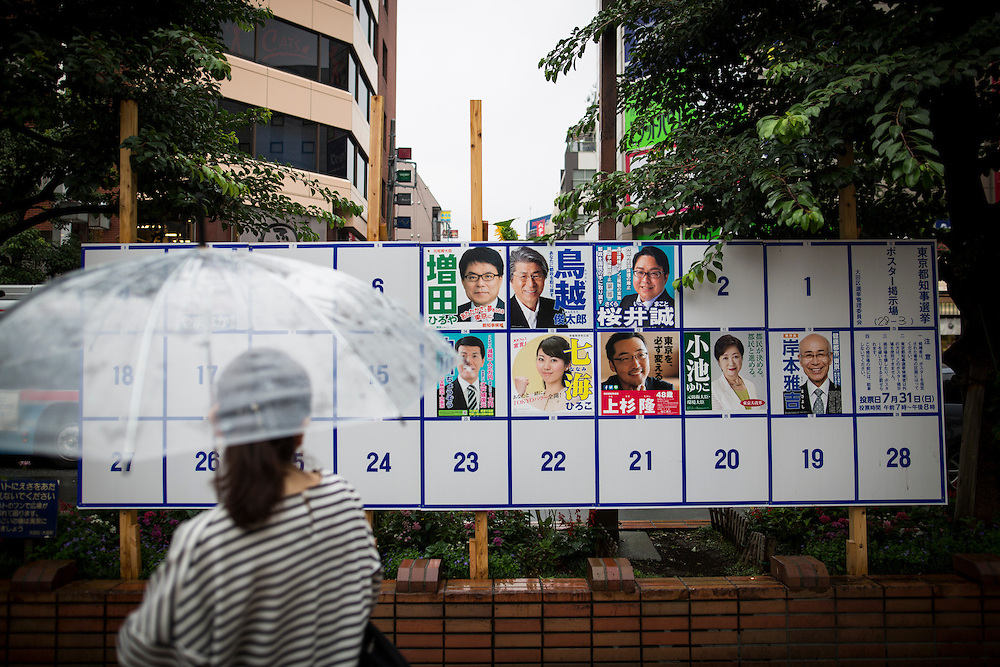 TOKYO, JAPAN - JULY 21 : A woman look at campaign posters with pictures of candidates for the Tokyo Gubernatorial Election 2016 at Omori station, Tokyo, Japan on Thursday, July 21, 2016. Tokyo residents will vote on July 31 for a new Governor of Tokyo who will deal with issues related to the hosting of the Tokyo Summer Olympics and Paralympics in 2020. (Photo: Richard Atrero de Guzman/NUR Photo)