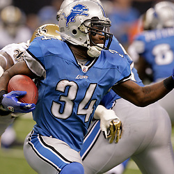 2009 September 13: Detroit Lions running back Kevin Smith (34) runs with the ball during a 45-27 win by the New Orleans Saints over the Detroit Lions at the Louisiana Superdome in New Orleans, Louisiana.