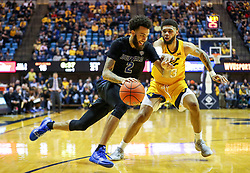 Nov 9, 2018; Morgantown, WV, USA; Buffalo Bulls guard Jeremy Harris (2) drives baseline past West Virginia Mountaineers forward Esa Ahmad (23) during the first half at WVU Coliseum. Mandatory Credit: Ben Queen-USA TODAY Sports