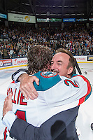 KELOWNA, CANADA - MAY 13: Kim Gellert and Tyson Baillie #24 of the Kelowna Rockets celebrate the WHL Championship title on May 13, 2015 during game 4 of the WHL final series at Prospera Place in Kelowna, British Columbia, Canada.  (Photo by Marissa Baecker/Shoot the Breeze)  *** Local Caption *** Kim Gellert; Tyson Baillie;
