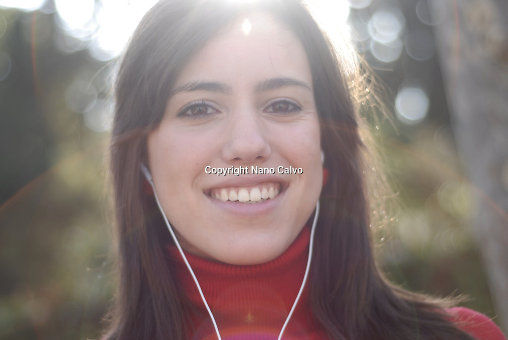 MR Portrait of a cute and sweet spanish teenager girl outdoors, in a park, Spain