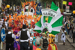 London, August 29th 2016. The procession begins on Ladbroke Grove during day two of Europe's biggest street party, the Notting Hill Carnival.