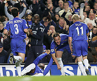 Photo: Lee Earle.<br /> Chelsea v Middlesbrough. The Barclays Premiership.<br /> 03/12/2005. Chelsea's John Terry is mobbed after scoring their opening goal.