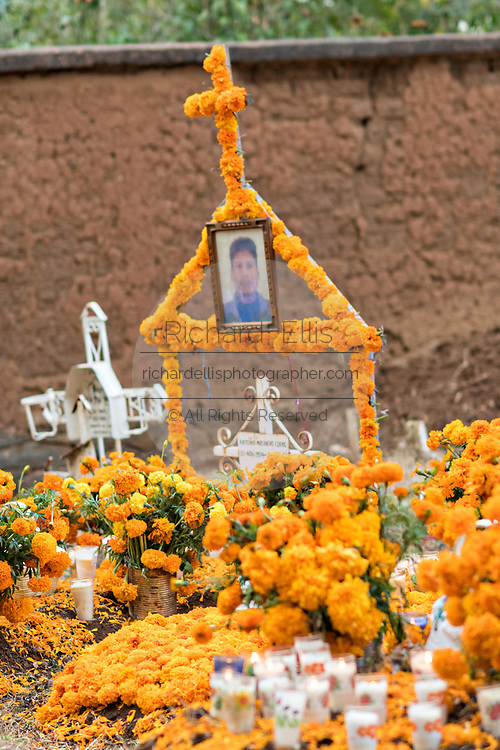 A decorated gravesite of a family member on the Day of the Dead festival October 31, 2017 in Tzintzuntzan, Michoacan, Mexico.
