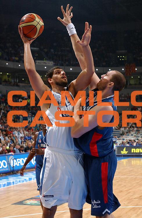 DESCRIZIONE : Belgrado Belgrade Eurobasket Men 2005 Francia Grecia<br /> GIOCATORE : Papadopoulos<br /> SQUADRA : Grecia Greece<br /> EVENTO : Eurobasket Men 2005 Campionati Europei Uomini 2005<br /> GARA : Francia Grecia France Greece<br /> DATA : 24/09/2005<br /> CATEGORIA :<br /> SPORT : Pallacanestro<br /> AUTORE : Ciamillo&amp;Castoria/Fiba Europe Pool