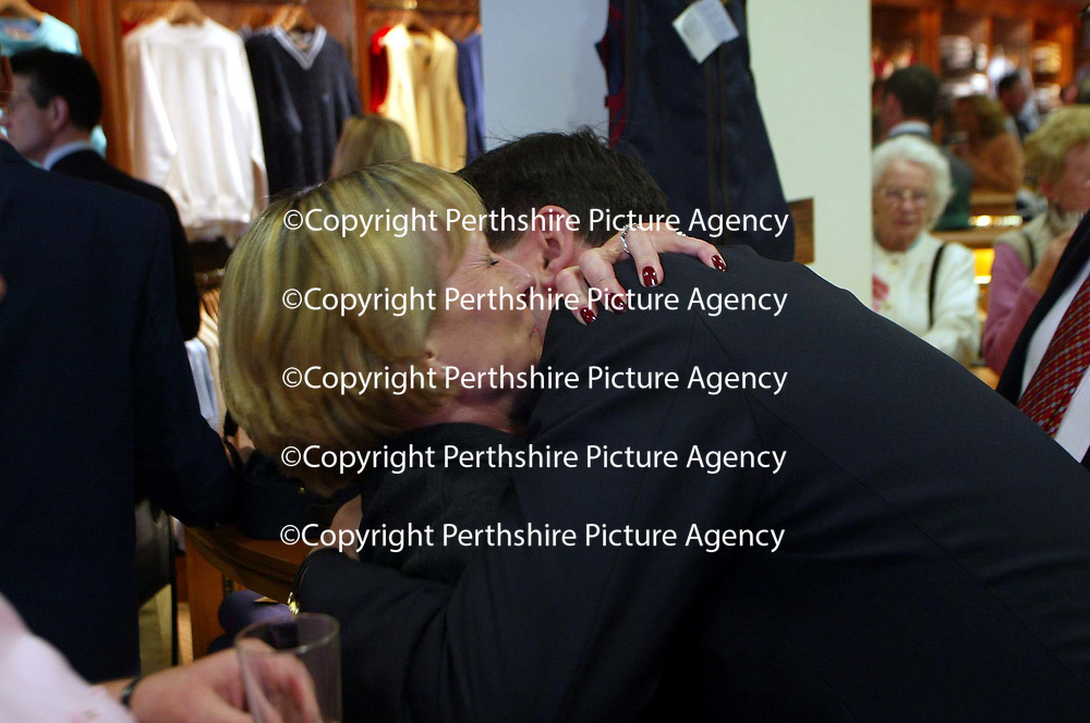 Patrick Birkbeck gets a hug at the Golf St Andrews shop, a joint venture between the House of Bruar and the R&amp;A<br /><br />Picture by Graeme Hart.<br />Copyright Perthshire Picture Agency<br />Tel: 01738 623350  Mobile: 07990 594431